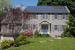 Photovoltaic solar panels on the roof of a hou...
